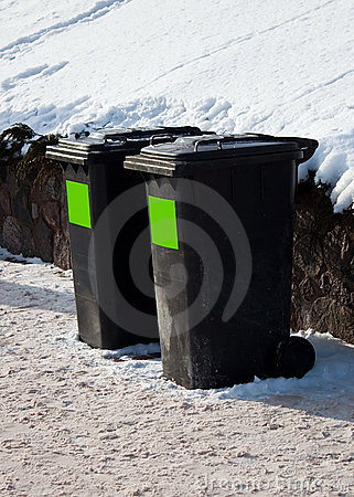 Two trash containers in winter street