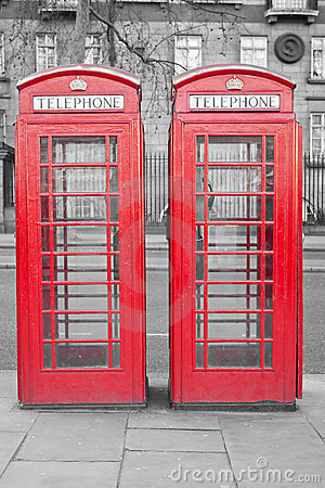Two typical London red phone cabins