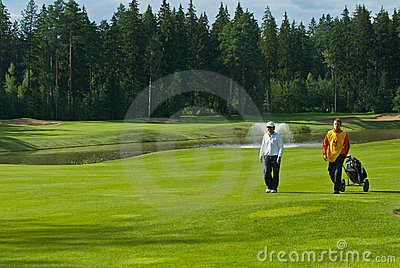 Two unknown golfer Editorial Stock Image