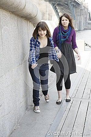 Two urban teen girls trying