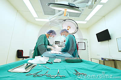 Two veterinarian doctor working in operating room Editorial Photography
