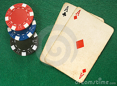 Two vintage aces and poker chips.