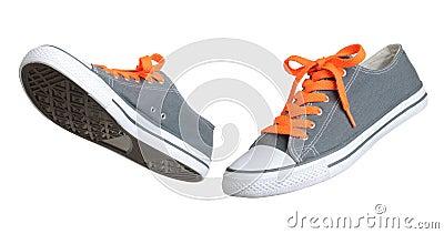 Two walking grey sneakers