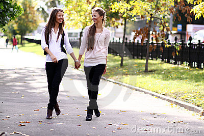 Two walking happy woman
