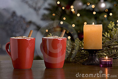 Two warm holiday drinks by the tree.