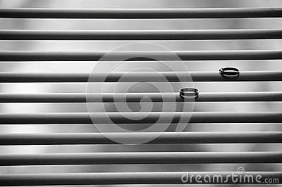 Two wedding rings on blinds