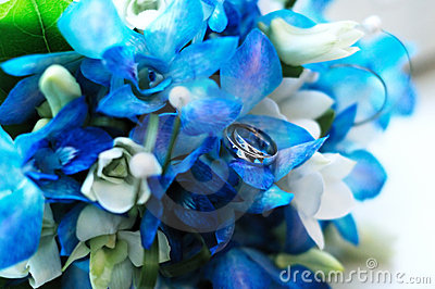 Two wedding rings on a wedding bouquet