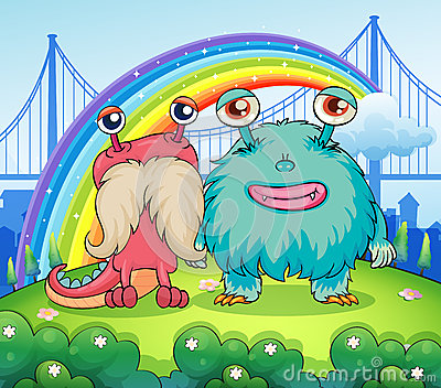Two weird monsters and a rainbow in the sky