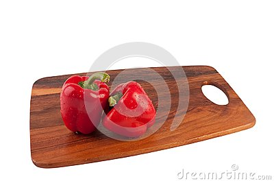 Two wet and peppers on cutting board