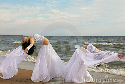 Two white angels on the beach