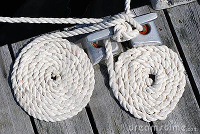 Two white boat ropes coiled up