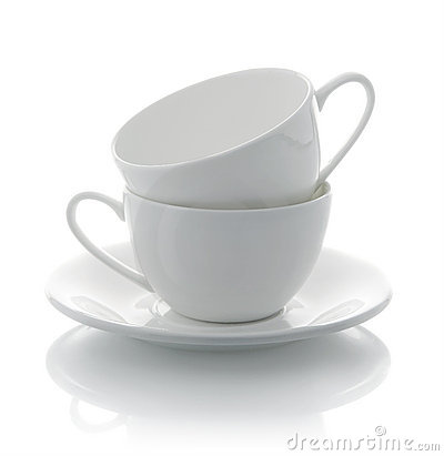 Two white cups and saucer