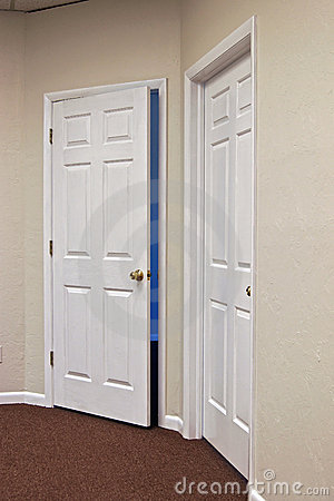Two white doors one open