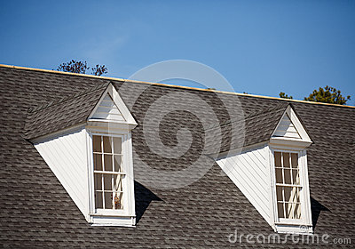 Two White Dormers on Grey Shingle Roof