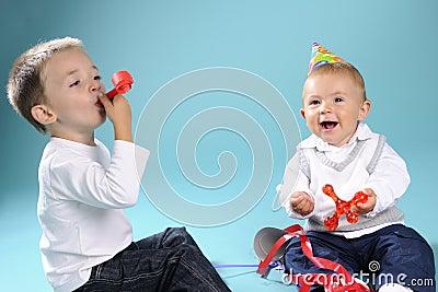 Two white happy children celebrating birthday