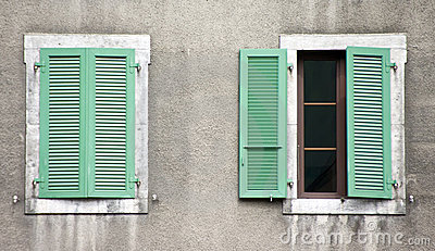 Two windows, green shutters
