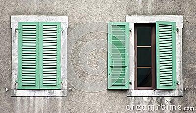 Two windows, green shutters