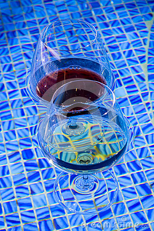 Two Wine Glasses Floating In Pool Stock Photo Image