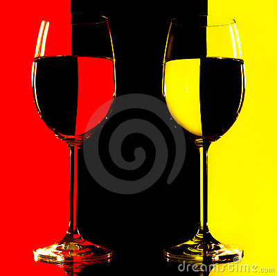 Free Two Wine Glasses In Backlight On The Red And Yello Royalty Free Stock Photos - 12878058