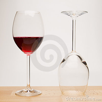 Two wine glasses on wood