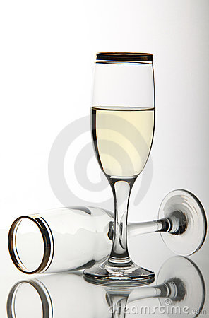 Two wine goblets on mirror surface