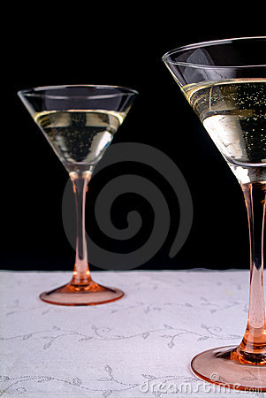 Two wineglasses on white tablecloth