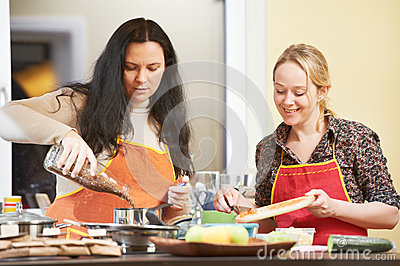Two woman cooking in kitchen