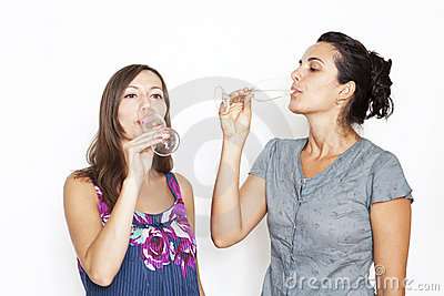 Two woman drinking champagne
