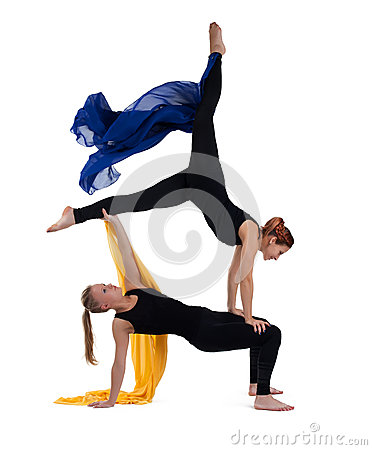 Two woman gymnast posing with flying cloth