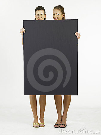 Two woman holding  card