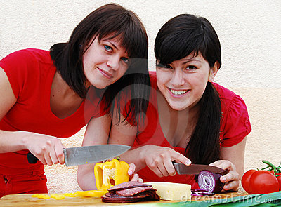 Two  woman preparing a meal