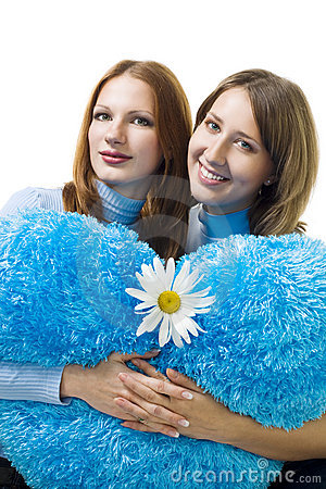 Two woman sit with camomile and teddy heart