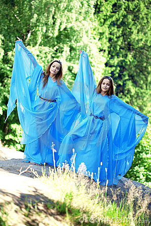 Two woman, twins in the forest