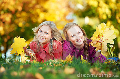 Two Women at autumn outdoors