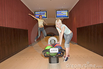 Two women bowling