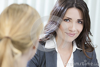 Two Women or Businesswomen in Office Meeting