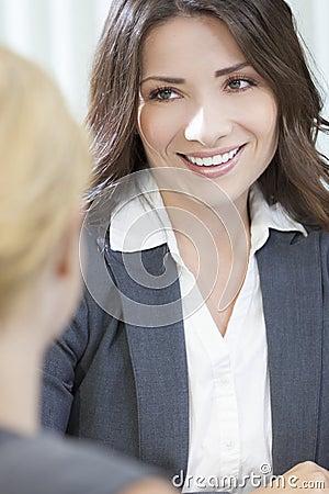 Two Women or Businesswomen in Office Meeting