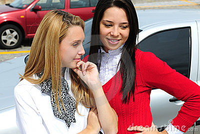 Two women buying a new car
