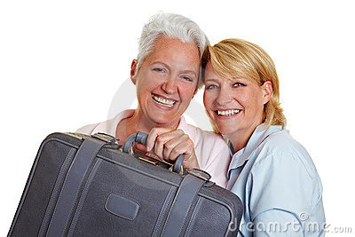 Two women carrying suitcase