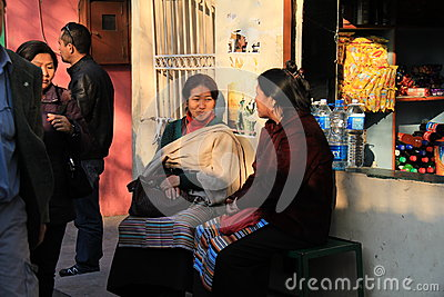 Two women catching up at tibet refugee place delhi Editorial Photo