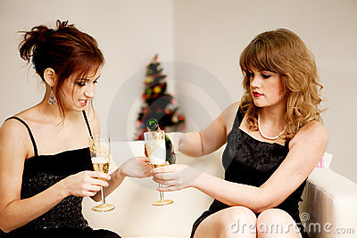 Two women celebrate christmas