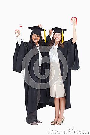 Two women celebrating their graduation
