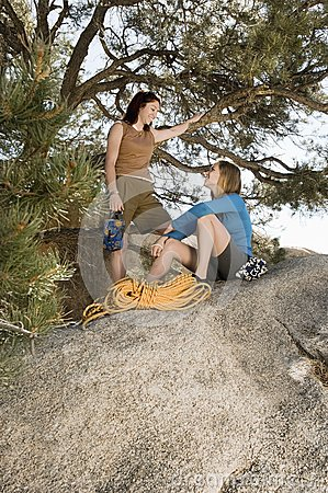 Two women climbers on boulder