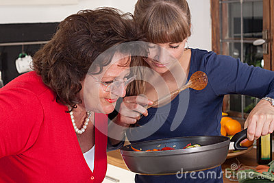 Two women are cooking
