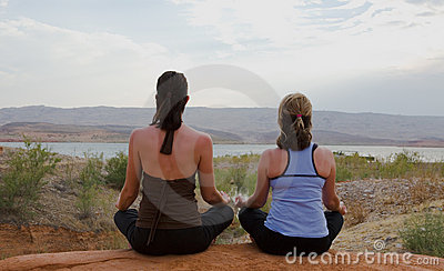 Two Women Doing Yoga at Sunset