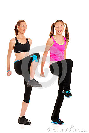 Two women doing zumba fitness