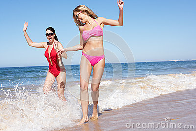 Two Women Enjoying Beach Holiday