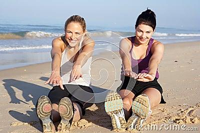 Two Women Exercising On Beach