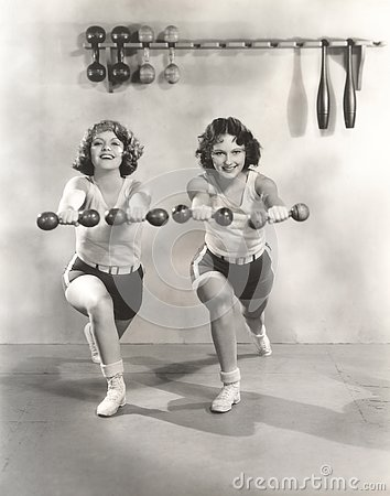 Free Two Women Exercising With Dumbbells At Gym Royalty Free Stock Image - 77561796