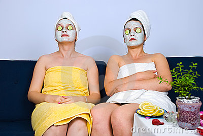 Two women with facial mask at spa